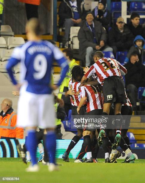Brentford's Sam Wood is congratulated by his team mates after scoring the first goal as Birmingham City's Kevin Phillips stands dejected