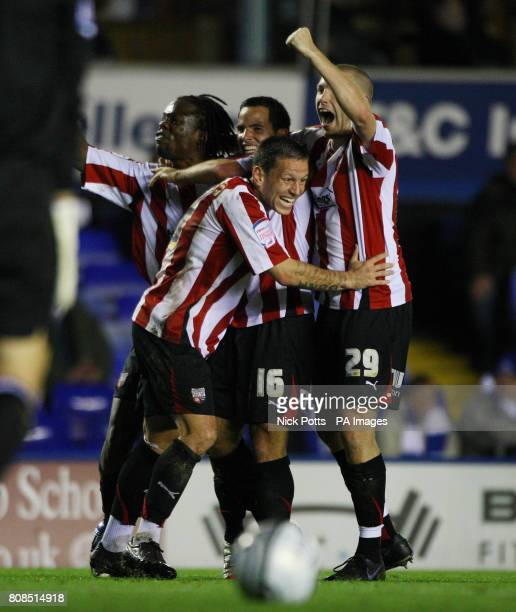 Brentford's Sam Wood is mobbed by Marcus Bean Charlie MacDonald and Gary Alexander after scoring the opening goal during the Carling Cup Fourth Round...