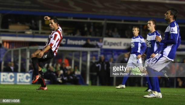 Brentford's Sam Wood scores the opening goal during the Carling Cup Fourth Round match at St Andrew's, Birmingham.