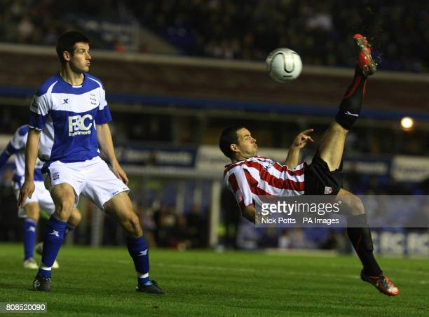 Brentford's Sam Wood shoots with an overheadkick past Birmingham City's Scott Dann during the Carling Cup Fourth Round match at St Andrew's,...