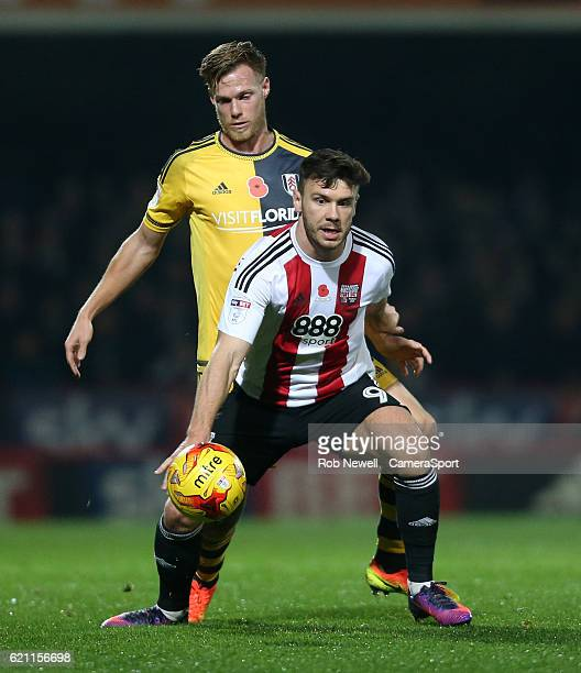 Brentford's Scott Hogan and Fulham's Tomas Kalas during the Sky Bet Championship match between Brentford and Fulham at Griffin Park on November 4...