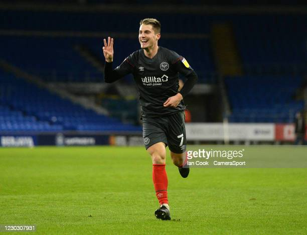 Brentford's Sergi Canos celebrates scoring his side's third goal during the Sky Bet Championship match between Cardiff City and Brentford at Cardiff...