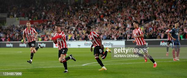 Brentford's Spanish striker Sergi Canos celebrates scoring the opening goal during the English Premier League football match between Brentford and...