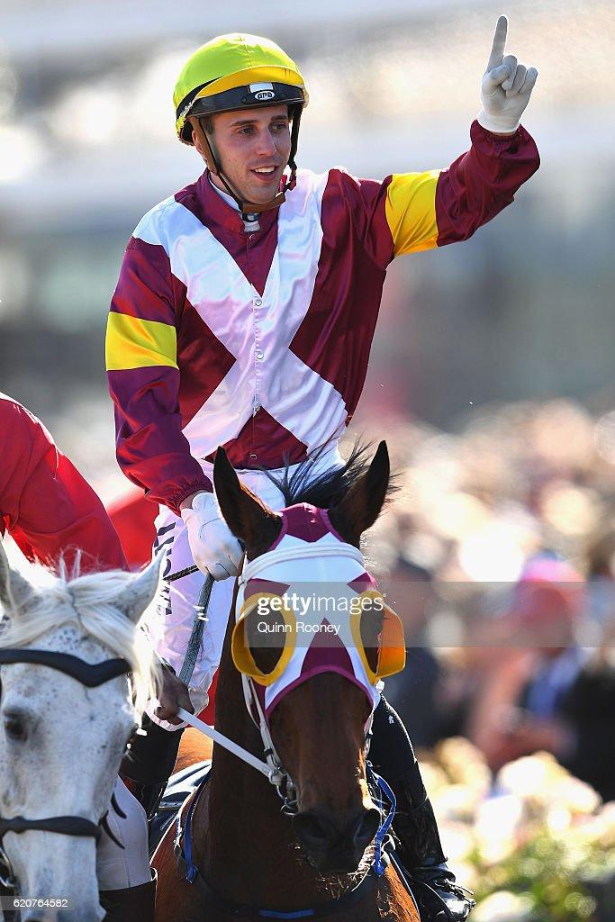 Brenton Avdulla rides Lasqueti Spirit returns to scale after winning race 8, the Crown Oaks on Oaks Day at Flemington Racecourse on November 3, 2016 in Melbourne, Australia.