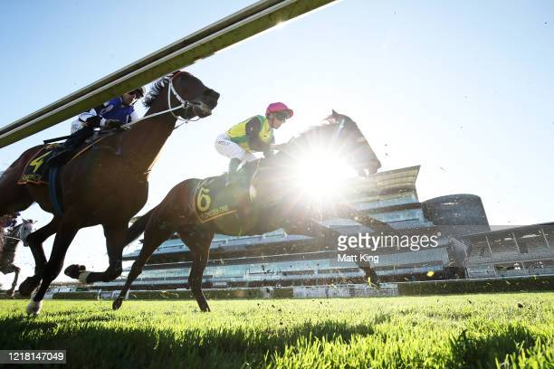 Brenton Avdulla riding Raheen House and Kerrin McEvoy riding The Chosen One pass the post for the first time Race 7Schweppes Sydney Cup during...