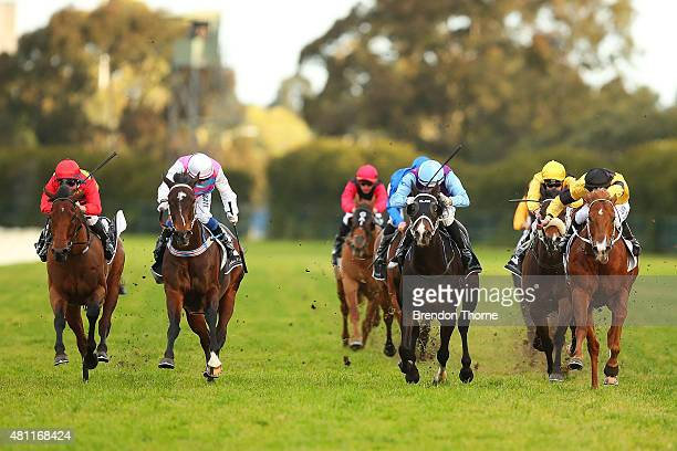 Brenton Avdulla riding 'Rugged Cross' leads the filed Race 7 Sydney Markets Limited Winter Stakes during Sydney Racing at Rosehill Gardens on July 18...