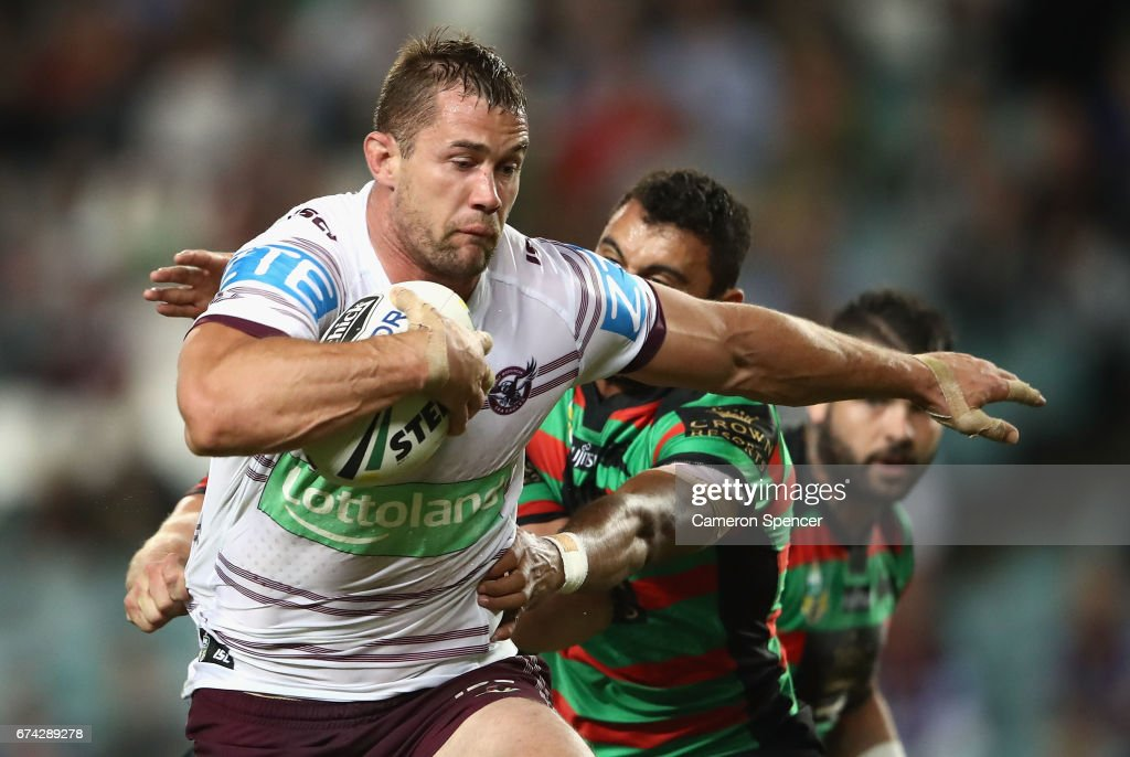 Brenton Lawrence of the Sea Eagles breaks through a tackle during the round nine NRL match between the South Sydney Rabbitohs and the Manly Sea Eagles at Allianz Stadium on April 28, 2017 in Sydney, Australia.