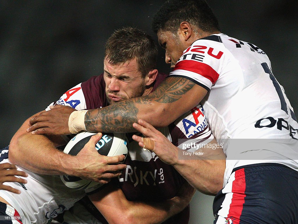 Brenton Lawrence of the Sea Eagles is tackled by the Roosters defenceduring the NRL trial match between the Manly Sea Eagles and the Sydney Roosters at Bluetongue Stadium on February 16, 2013 in Gosford, Australia.