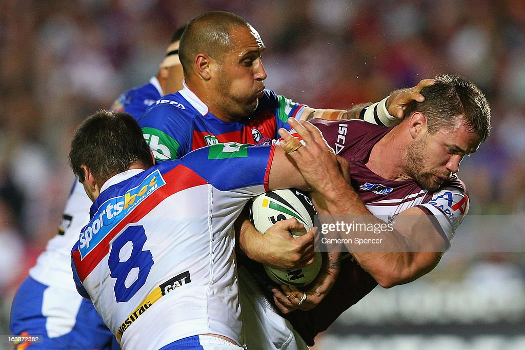 Brenton Lawrence of the Sea Eagles is tackled during the round two NRL match between the Manly Sea Eagles and the Newcastle Knights at Brookvale Oval on March 17, 2013 in Sydney, Australia.