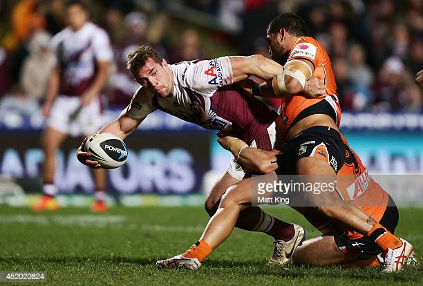 Brenton Lawrence of the Sea Eagles offloads the ball in a tackle during the round 18 NRL match between the Manly Warringah Sea Eagles and the Wests...