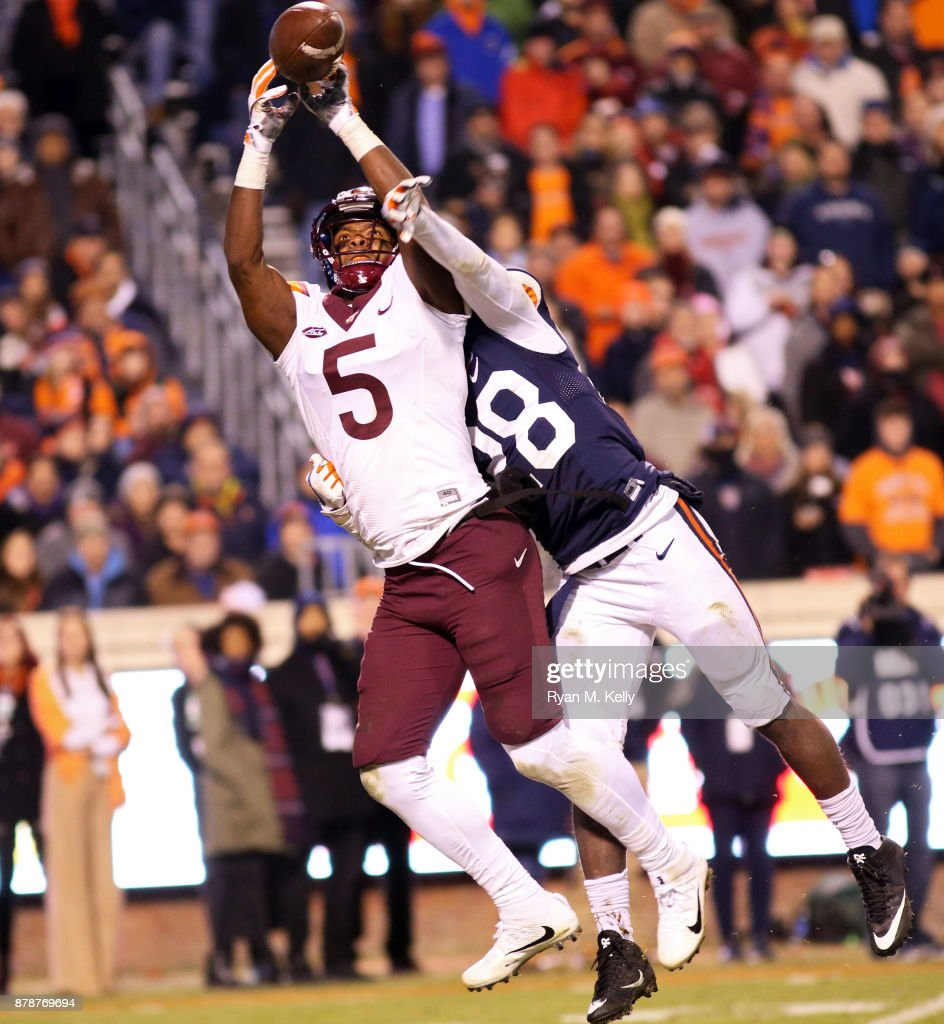 Brenton Nelson #28 of the Virginia Cavaliers breaks up a pass intended for Cam Phillips #5 of the Virginia Tech Hokies in the third quarter during a game at Scott Stadium on November 24, 2017 in Charlottesville, Virginia. Virginia Tech defeated Virginia 10-0.