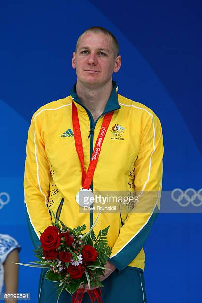 Brenton Rickard of Australia poses with the silver medal during the medal ceremony for the Men's 200m Breaststroke held at the National Aquatics...