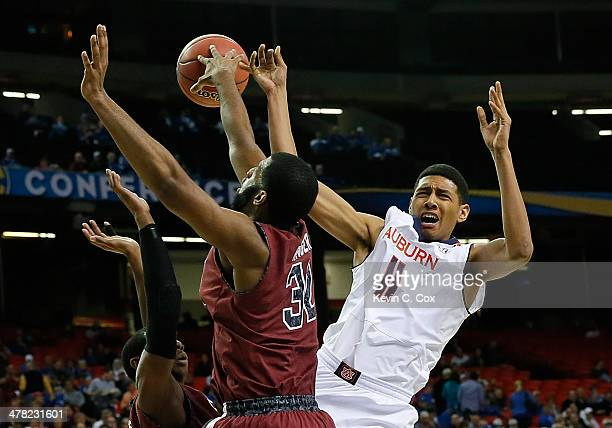 Brenton Williams defends as Desmond Ringer of the South Carolina Gamecocks blocks a shot by Dion Wade of the Auburn Tigers during the first round of...