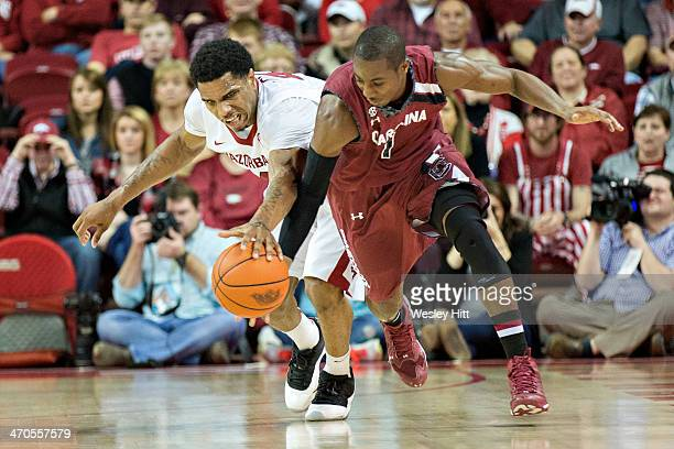Brenton Williams of the South Carolina Gamecocks has the ball stolen by Coty Clarke of the Arkansas Razorbacks at Bud Walton Arena on February 19,...