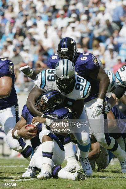 Brentson Buckner of the Carolina Panthers make the tackle during the game against the Baltimore Ravens on September 8 2002 at Ericsson Stadium in...