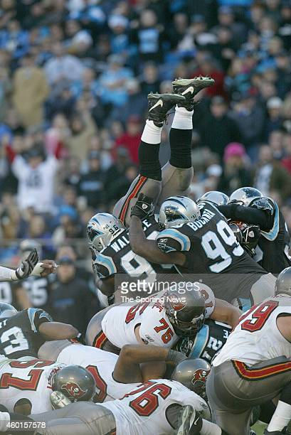 Brentson Buckner of the Carolina Panthers makes a tackle during a game against the Tampa Bay Buccaneers on December 11 2005 at the Bank of America...