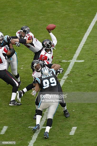 Brentson Buckner of the Carolina Panthers rushes the pass against Michael Vick of the Atlanta Falcons on December 4 2005 at the Bank of America...