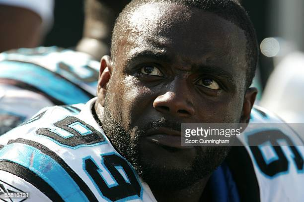 Brentson Buckner of the Carolina Panthers watches the action against the New England Patriots at Bank of America Stadium on September 18 2005 in...