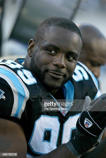 Brentson Buckner of the Carolina sits on the sideline during a game against the Minnesota Vikings on October 30 2005 at the Bank of America Stadium...
