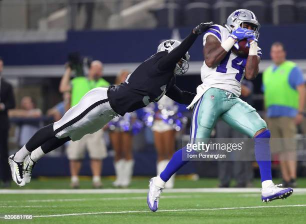 Breon Borders of the Oakland Raiders tries to break up a pass to Lance Lenoir of the Dallas Cowboys that resulted in a touchdown in the fourth...