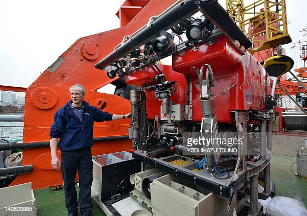 Brermen University marine environmental science center researcher Volker Ratmeyer displays a remotely operated vehicle on the deck of a German...