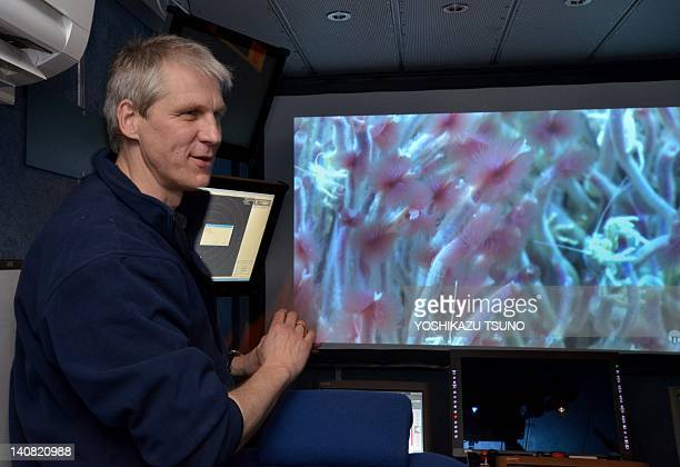 Brermen University marine environmental science center researcher Volker Ratmeyer displays an image captured by a remotely operated vehicle at an...
