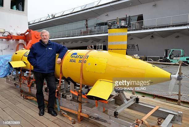 Brermen University marine environmental science center researcher Gerold Wefer displays an autonomous underwater vehicle on a German research ship...