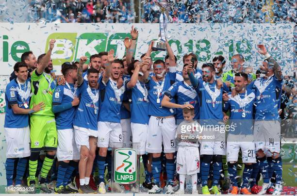 Brescia Calcio players celebrate with the trophy after winning the Serie B Championship at the end of the Serie B match between Brescia Calcio and...