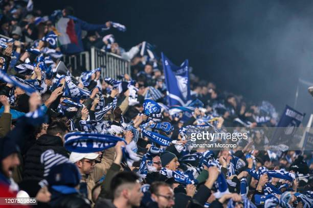 Brescia fans wave scarves abovew their heads during the Serie A match between Brescia Calcio and SSC Napoli at Stadio Mario Rigamonti on February 21...