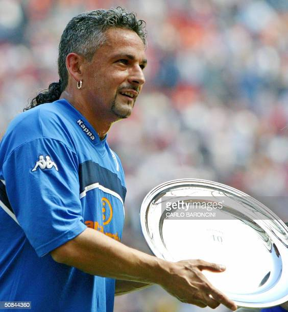 Brescia's captain Roberto Baggio holds a trophy received for his career prior their Italian Serie A football match against AC Milan at San Siro...