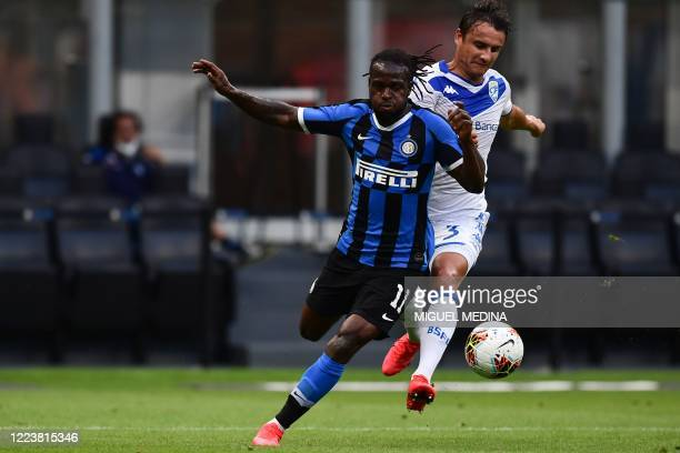 Brescia's Czech midfielder Ales Mateju fouls Inter Milan's Nigerian defender Victor Moses in the penalty area during the Italian Serie A football...