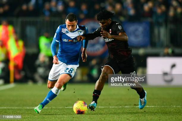 Brescia's Italian Brazilian defender Romulo fights for the ball with AC Milan's Ivorian midfielder Franck Kessie during the Italian Serie A football...
