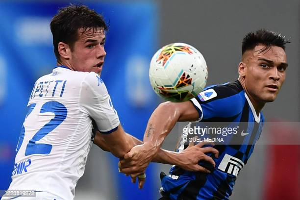 Brescia's Italian defender Andrea Papetti and Inter Milan's Argentinian forward Lautaro Martinez go for the ball during the Italian Serie A football...