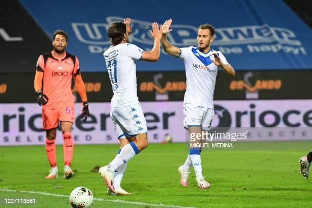 Brescia's Italian forward Ernesto Torregrossa celebrates with Brescia's Italian forward Alfredo Donnarumma after scoring his team's first goal the...