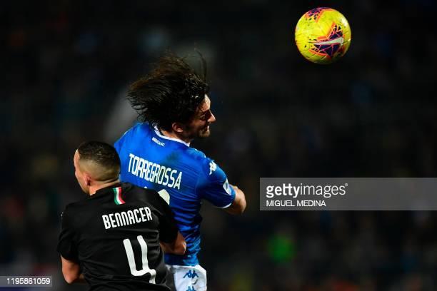 Brescia's Italian forward Ernesto Torregrossa fights for the ball with AC Milan's Algerian defender Ismael Bennacer during the Italian Serie A...