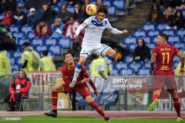 Brescia's Italian forward Ernesto Torregrossa goes for a header during the Italian Serie A football match Roma vs Brescia on November 24 2019 at the...