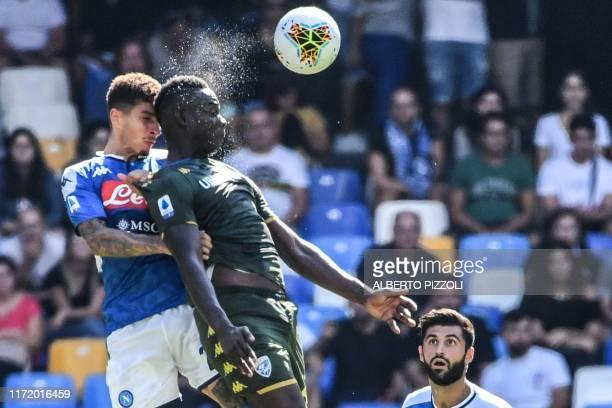 Brescia's Italian forward Mario Balotelli and Napoli's Italian defender Giovanni Di Lorenzo go for a header during the Italian Serie A football match...