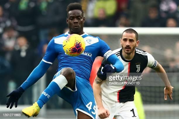 Brescia's Italian forward Mario Balotelli challenges Juventus' Italian defender Leonardo Bonucci during the Italian Serie A football match Juventus...