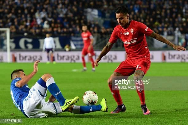 Brescia's Italian midfielder Daniele Dessena and Fiorentina's Chilean midfielder Erick Pulgar go for the ball during the Italian Serie A football...