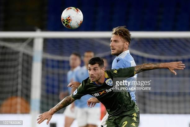 Brescia's Italian midfielder Stefano Sabelli vies with Lazio's Italian forward Ciro Immobile during the Serie A football match Lazio vs Brescia at...