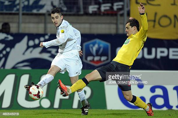 Bressuire's midfielder Sebastien Lecante vies with Sochaux's French defender Julien Faussurier during the French Cup football match between Bressuire...