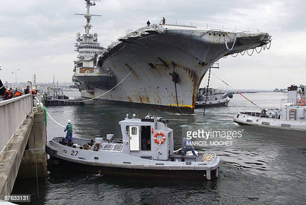 Hull 790 aka giant aircraft carrier Clemenceau once a symbol of France's naval might is led by tugboats upon its arrival 17 May 2006 at the military...