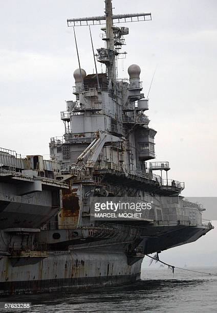 Hull 790 aka giant aircraft carrier Clemenceau once a symbol of France's naval might arrives 17 May 2006 at the military seaport of Brest after...