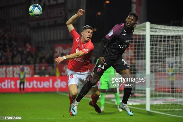 Brest' French defender Romain Perraud vies with Metz' French-Senegalese midfielder Opa Nguette during the French L1 football match between Stade...