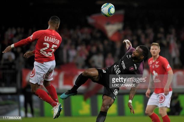 Brest' French midfielder Samuel Grandsir heads the ball past Metz' Ivorian midfielder Habib Maiga during the French L1 football match between Stade...