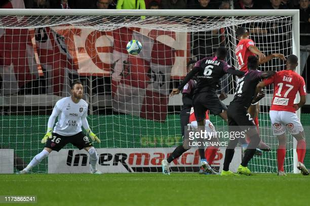 Brest's defender Jean-Charles Castelletto heads to score during the French L1 football match between Stade Brestois 29 and Football Club de Metz at...