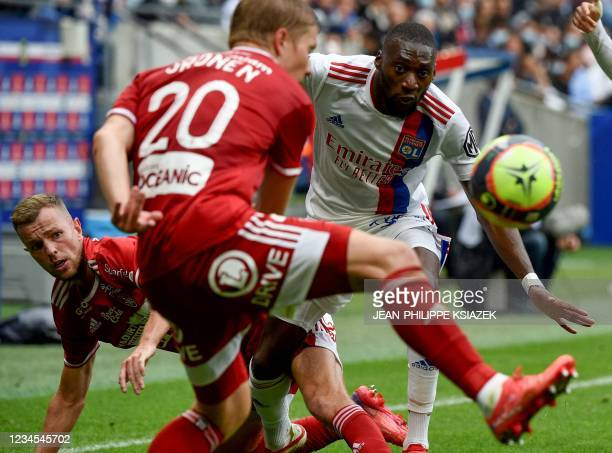 Brest's Finnish defender Jere Uronen fights for the ball with Lyon's Cameroonian forward Karl Toko Ekambi during the French L1 football match between...