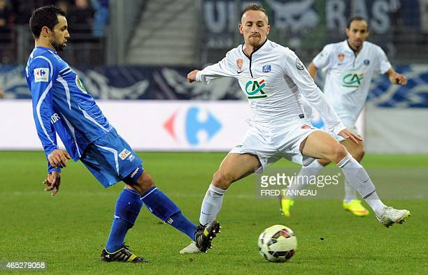 Brest's forward Gaetan Courtet vies with Auxerre's midfielder Jamel Ait Ben Idir during the French Cup football match Brest vs Auxerre on March 5...