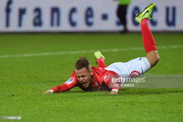 Brest's forward Irvin Cardona falls on the pitch during the French L1 football match between Stade Brestois 29 and Football Club de Metz at the...
