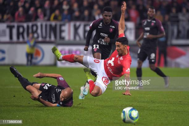 Brest's French defender Gaetan Belaud vies with Metz' French midfielder Renaud Cohade during the French L1 football match between Stade Brestois 29...